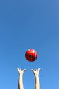 Red Ball Thrown In The Air Royalty Free Stock Photography - 56201647