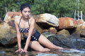 Woman In Swimsuit Sitting On The Rocks Stock Photo - 56228200