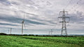Wind Power And Electricity Pylons Stock Image - 56229081