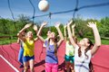 Teenagers Are Playing Volleyball Together Near Net Royalty Free Stock Image - 56231696