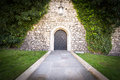 Small Door At Stone Wall Of Old Castle. Royalty Free Stock Photo - 56272345
