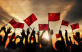 Silhouettes Of People Holding The Flag Of China Royalty Free Stock Photo - 56297275