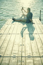 Couple In Love Sitting On The Pier, Selfie Stock Photo - 56321410