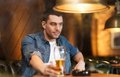 Man Drinking Beer And Smoking Cigarette At Bar Royalty Free Stock Images - 56341339