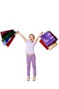 Happy Girl With Shopping Bags Standing At Studio Stock Photo - 56356460