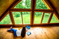 Woman Working On The Floor In Wooden House Stock Image - 56358211