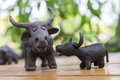 Father And Son Buffalo Clay Sculpture On Wooden Background In Ou Stock Photo - 56363570