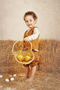 Beautiful Curly-haired Boy Holding Ducklings In A Basket Royalty Free Stock Images - 56366389