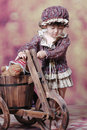 Chinese Girl With Wooden Tricycles Royalty Free Stock Photos - 5645318