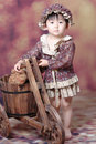 Chinese Girl With Wooden Tricycles Royalty Free Stock Images - 5645439