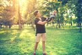Portrait Of Father And Son Having Fun In Park, Father Holding Baby, Infant. Concept Of Family Day In The Park With Young Parents Stock Photos - 56411623