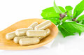 Yellow Herbal Medicine On Wooden Spoon With Green Leaf Royalty Free Stock Images - 56429529