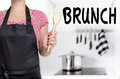 Brunch Cook Holding Wooden Spoon Background Royalty Free Stock Image - 56432976