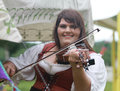 Renaissance Fair Woman In Costume Plays Fiddle Royalty Free Stock Photos - 56445618