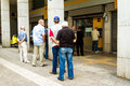 Greek Citizens Line Up At An ATM Royalty Free Stock Image - 56465346