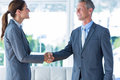 Two Business Workers Shake Hands Stock Photos - 56479933