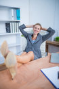 Smiling Blonde Businesswoman Relaxing Herself Stock Image - 56483801