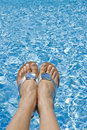 Feet Over The Swimming Pool Stock Images - 5656224