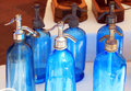 Antique Blue Soda Syphon Bottles On Flea Market Stock Images - 56506044