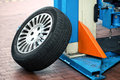 Car Wheel Leaning Up Against A Hoist Stock Images - 56515214