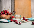 Cherries Berries Preserving With Glass Jar On Rustic Kitchen Table Royalty Free Stock Images - 56527889