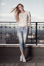 Fashion Model. Summer Look. Jeans, Sneakers, Sweater. Royalty Free Stock Photo - 56528135