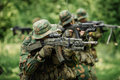 Group Of Soldiers Special Forces During The Raid In The Forest Stock Image - 56530971