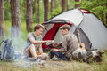 A Person Pouring Tea Into His Friends Cup While Camping Stock Photos - 56539083