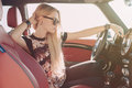 Blondie Young Girl At The Wheel Of Sport Car Stock Image - 56540881