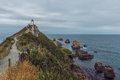 Lighthouse At Nugget Point New Zealand Stock Images - 56553634