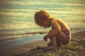 Little Boy In Red Shorts Played On The Beach Stock Photos - 56568093
