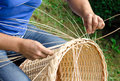 Man S Hands Making A Wicker Basket. Royalty Free Stock Image - 56605596