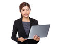 Asian Businesswoman Use Of The Notebook Computer Royalty Free Stock Photo - 56637825