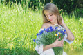 Happy Woman Wit Bouquet Of Chamomiles And Cornflowers Royalty Free Stock Photo - 56695905