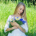 Happy Woman Wit Bouquet Of Chamomiles And Cornflowers Royalty Free Stock Photos - 56696838