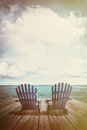 Adirondack Chairs On Dock With Vintage Textures And Feel Royalty Free Stock Photography - 56707607