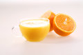 Orange Juice In A Transparent Cup And Halves Of A Juicy Ripe Ora Stock Photography - 56718092