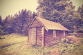 Vintage Filtered Wooden Hut In Forest. Stock Images - 56719154