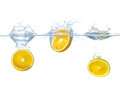 Oranges Falling Into Water With Splashes Stock Images - 56720284