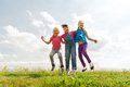 Group Of Happy Kids Jumping High On Green Field Stock Image - 56720371