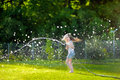 Adorable Little Girl Playing With A Garden Hose Royalty Free Stock Photo - 56739735