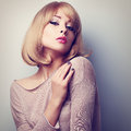 Sexy Female Model Posing With Blond Short Hair Style. Color Tone Stock Photos - 56742113
