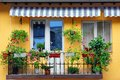 Yellow Building Wall With Balcony Flowery Garden Royalty Free Stock Image - 56755736
