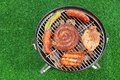 Assorted Meet Products On Hot BBQ Grill. High Angle View Royalty Free Stock Photos - 56755758