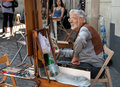 Painter And His Easel At Place Du Tertre In Montmartre Of Paris Stock Photo - 56765450