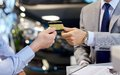 Customer Giving Credit Card To Car Dealer In Salon Royalty Free Stock Photography - 56768357