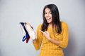 Happy Young Woman Pointing Finger On Shoes Stock Photos - 56772563