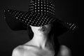 Fashion Portrait Of A Woman With Black And White Dots Hat And Pout Lips Stock Image - 56780301