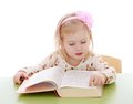 Little Caucasian Blond Girl Sitting At A Desk And Royalty Free Stock Image - 56789026