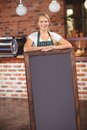 Pretty Waitress Holding A Big Chalkboard Stock Images - 56791914